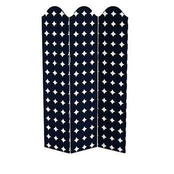 A curved upholstered screen from Iris Apfel's home line with HSN in navy blue with white diamond pattern.