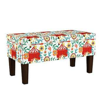 A storage bench from Iris Apfel's home line with HSN in white with circus tent and floral pattern.