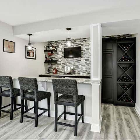 A wet bar in this new home by Beazer Homes includes a space to store wines, a wet bar, counter space and bar seating.