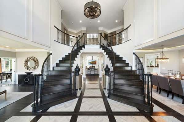 This new home from Toll Brothers has a grand entrance with double staircases in the foyer.