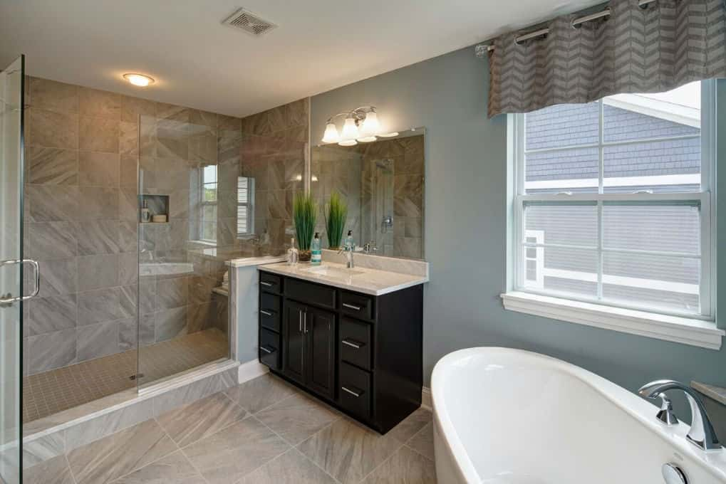 Lexington Homes has been increasing the size of shower stalls, like this one in a new home at Lexington Towne at Arlington Heights in Arlington Heights, Ill. The master bathroom also includes a soaker tub.