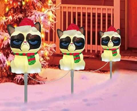 A set of three outdoor lights with Grumpy Cat with a Santa hat and green-and-red scarf.