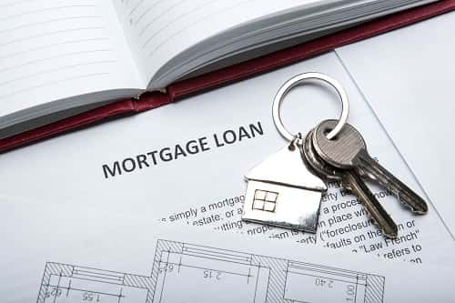 Keys to new home sit on top of mortgage loan paperwork