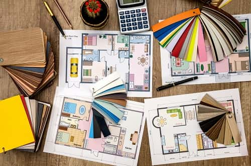 Color swatches, new home floor plans,  fabric and flooring samples spread on a table for buyers to make decisions