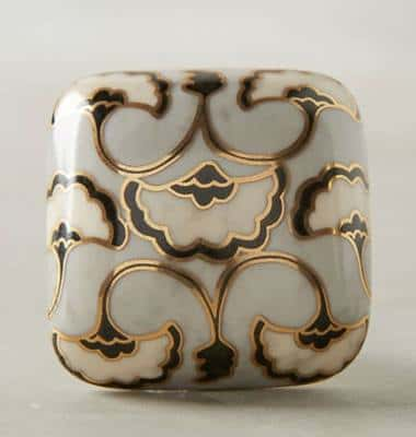 Arabesque cabinet knob with ornate veining.