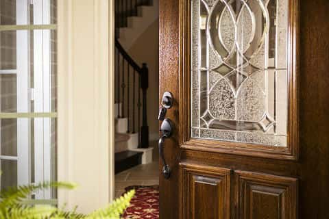 Lovely Open Front Door Of Upscale Modern Home, Welcomes New Homeowners And Guests.  Door Is