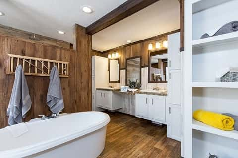 Clayton Homes' Aspen Plan in Como, Miss., has a master bath with luxury features such as a soaking tub, wood floors, double vanities and plenty of storage.