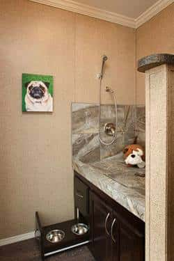A dog washing station in the Ashford Plan by Clayton Homes makes it easy to bathe pets without making too much of a mess of the home.