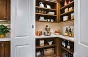 Keep your kitchen pantry organized and tidy with plenty of shelves and counter space, like this kitchen pantry in the Residence 1 plan by Irvine Pacific. At the Marin community in Irvine, Calif.