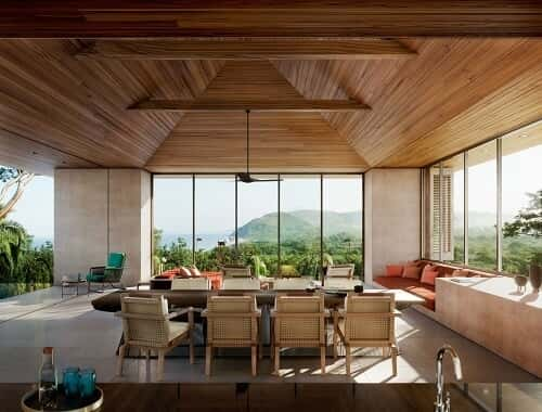 An open, airy living space overlooking mountain scenery.
