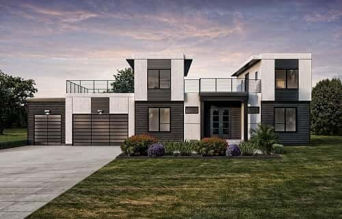 A modern, monochrome exterior with solar panels and Tesla Powerwalls.