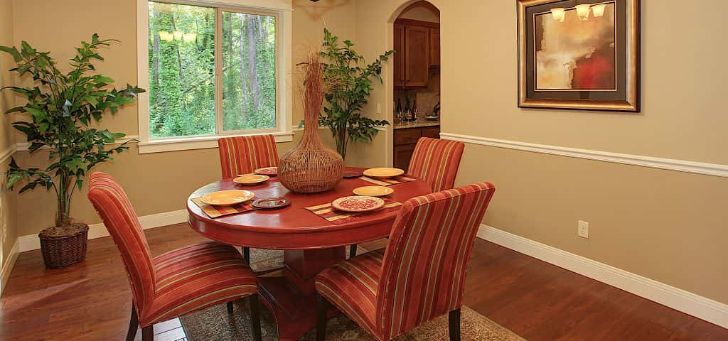 "<p >Though most people are not looking for a formal floor plan, they like to keep the formal dining room for big events, says Bradford. The most common buyers of the Adams plan are boomers, especially those that are grandparents. ""They're the destination for the holidays,"" Bradford says, so they need a space that can house a table big enough to accommodate their guests.""<br /> <br /> This living room with chair-rail molding and arched doorways is more than just stylish: opening up to a walk-in butler's pantry, it's also a hub for storage and kitchenware organization.</p> <p >PHOTO COURTESY OF<br /> Garrette Custom Homes</p>"