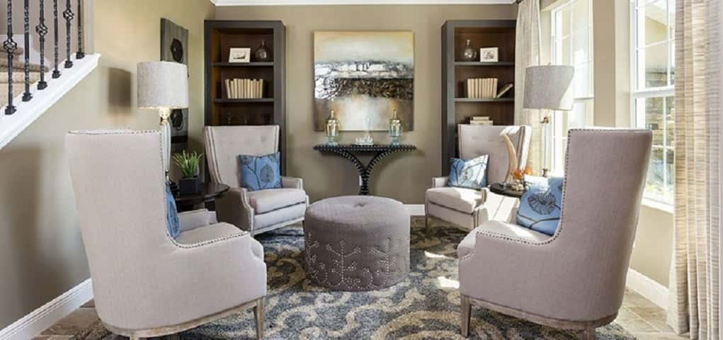 "Sometimes you just need a comfortable space to read that's not a couch or your bed. Enter Royal Oaks Homes' <a href=""https://www.newhomesource.com/resourcecenter/slideshows/home-of-the-week-parker-plan-by-royal-oaks-homes"" target=""_blank"" title=""Home of the Week: Parker Plan by Royal Oaks Homes"">Parker plan</a>'s home office. This sitting space is lit by the sun and a small lamp.<br /> <br /> Four armchairs and a round ottoman create a great gathering space for family and friends after dinner or on a quiet Saturday afternoon. Forget work, a simple table is transformed into a small home bar, making entertaining in this space relatively simple.<br /> <br /> PHOTO COURTESY OF<br /> Royal Oaks Homes"