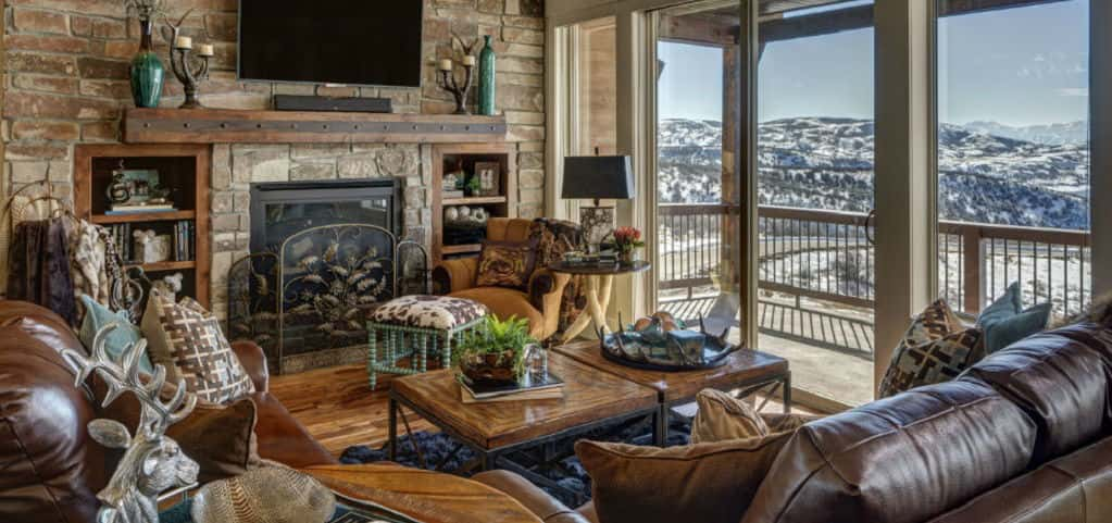 Even without the stunning view of this Utah mountain range, this great room remains on top. Dark leather sofas, hardwood floors and a stone wall complete with fireplace make this mountaintop getaway a place you'd want to stay in forever.<br /> <br /> Throw in some deer-themed accent pieces, some rustic furniture and a perfect patio and you've completed that dream home, log cabin feel.<br /> <br /> PHOTO COURTESY OF<br /> GCD