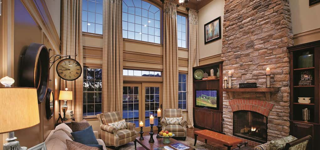 "Soaring ceilings, a stone fireplace and sophisticated trim create a space that is at once striking and cozy. Entertain guests or spend the evening in quiet contemplation — this adaptable space ensures you'll do it in style!<br /> <br /> While Toll Brothers offers an option to add living space to the second floor of the two-story family room, many buyers tend to leave it as a two-story. ""It definitely adds to the looks of the home as you leave the foyer into this grand family room,"" says Brian Thierrin, Division Senior Vice President for Toll Brothers.<br /> <br /> PHOTO COURTESY OF<br /> Toll Brothers"