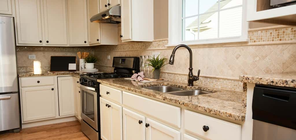 <p>A functional kitchen is spaced well enough to be both functional and stylish. An abundance of cabinets provide enough storage for all of a homeowner's needs.<br /> <br /> McCracken says that in addition to stainless steel appliances, they also come in black and white, as well as built-in. One option homeowners might enjoy? A raised dishwasher, which makes it easier to load and unload.</p> <p >PHOTO COURTESY OF<br /> Del Webb</p>