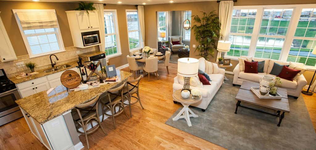 "<p>An open floor plan creates spaciousness in the Abbeyville's great room, connecting the living space, kitchen and eating areas.<br /> <br /> ""This home is the perfect size with a feeling of openness,"" says McCracken. ""Buyers appreciate the open floor plan because it's great for entertaining or even watching TV while you cook.""</p> <p >PHOTO COURTESY OF<br /> Del Webb</p>"