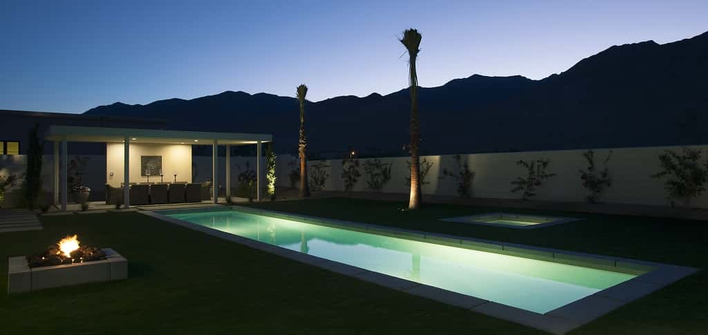 "The Modern Villa Plan by <a href=""http://www.newhomesource.com/builder/alta-verde-group/about/7602"" target=""_blank"" title=""Learn more about Alta Verde Group"">Alta Verde Group </a>at Alta Verde Monte Sereno in Palm Springs, Calif., blends lavish modern architecture with a Mediterranean-inspired aesthetic.<br /> <br /> The sleek, long pool is an essential focal point for the patio and outdoor area, as well as the home itself. The home has large glass windows and sliding glass doors showing a gorgeous view of the nearby mountains as well as the pool.<br /> <br /> PHOTO COURTESY OF <br /> Alta Verde Group"