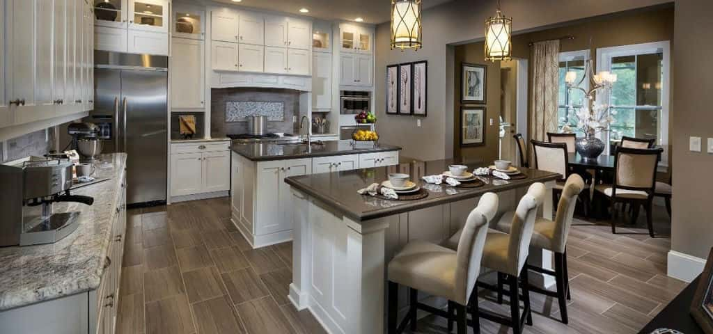 With seven floor plans to choose from, your perfect personalized home is ready to be built for you. Any of the homes can be a true reflection of your style and passions — whether they are inspired by the nature-rich surroundings or by your own imagination.<br /> <br /> One customizable feature in the Durango Plan, for instance, is the double kitchen islands shown here. You could also opt for a single, rounded-out kitchen island if you prefer.<br /> <br /> PHOTO COURTESY OF<br /> Ashton Woods Homes