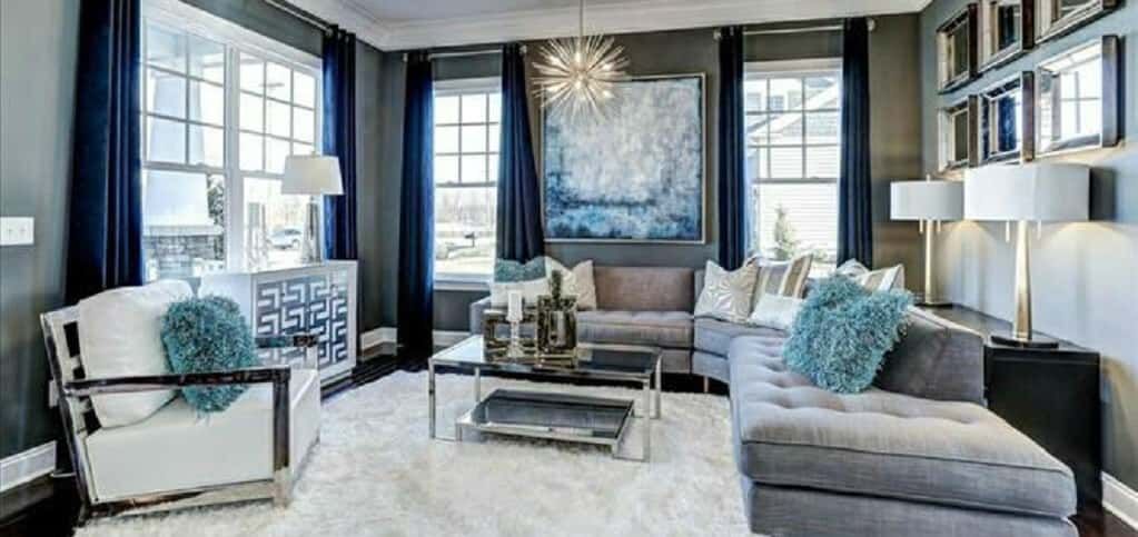 Lots of windows bring in natural sunlight to the home's spacious living room. <br /> <br /> Elegantly decked out in a light blue and silver palette, this space is ideal for family time or friendly gatherings.<br /> <br /> PHOTOS COURTESY OF<br /> Beazer Homes