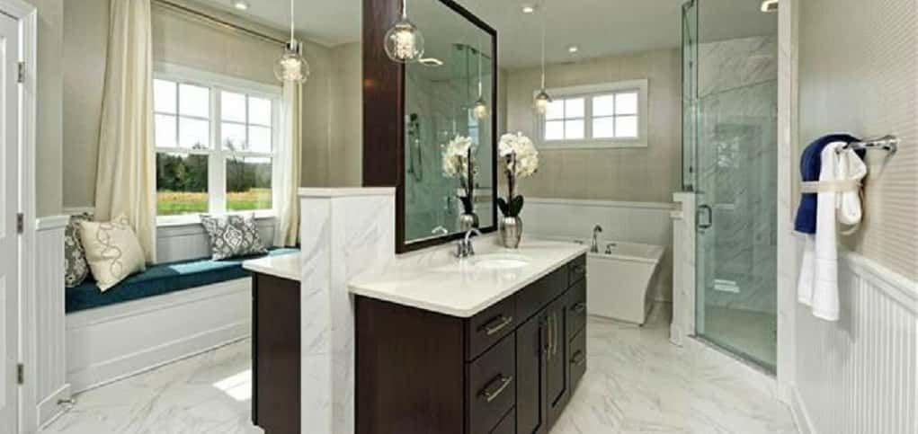 Who wouldn't love a master bathroom like this one in the Brighton plan? A glass-encased shower and separate soaking tub are perfect for washing away the day's troubles. And a sitting bench allows buyers to take it easy while preparing for the day.<br /> <br /> A double vanity keeps clutter at bay and makes it convenient to get ready in the morning.<br /> <br /> PHOTOS COURTESY OF<br /> Beazer Homes