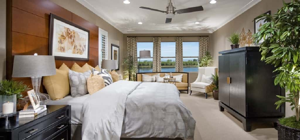 "<p>With a view like that, you could feel like you're in your own oasis in this main-level Owner's Suite. ""Many owners love that feature for easy access and waterfront morning coffee to enjoy the view,"" says Jackie Gentile, vice president of sales and marketing at Lafferty Communities. ""A great way to start your day."" <br /> <br /> Other features include six colors of carpeting for you to choose from, separate double sinks, large walk-in closets, coffer ceilings, Piedrafina counters and more!</p> <p >PHOTO COURTESY OF<br /> Lafferty Communities</p>"
