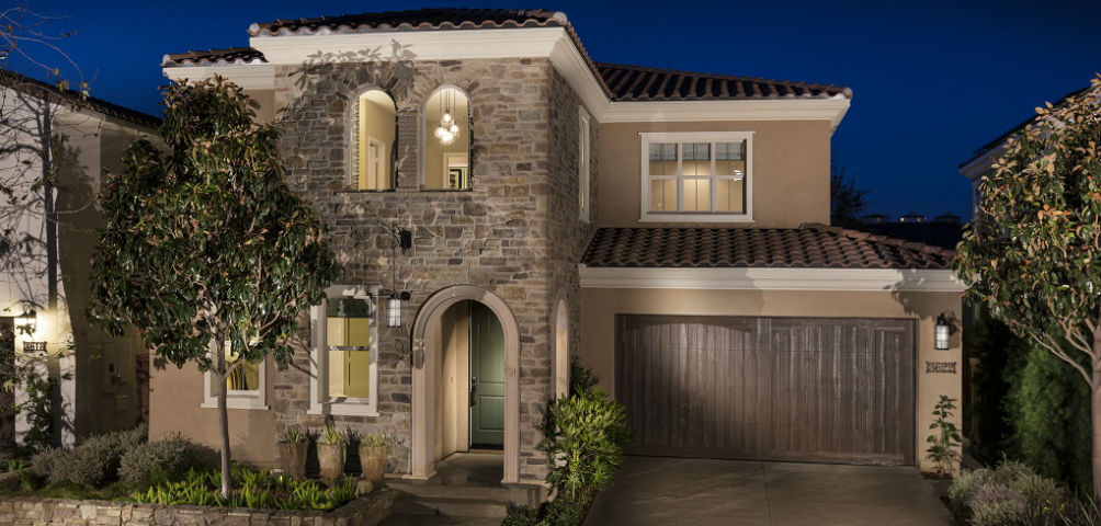 "<p>An Italian Tuscany exterior includes an arched stone entryway to the Residence 3 Plan from Brookfield Residential SoCal, providing homeowners with a welcoming entrance. ""It's such a comforting way to greet guests,"" says Vallery DeVilbiss, sales representative for the company's Palo Verde division.<br /> <br /> Buyers can choose from three exteriors: Italian Tuscany, Mission style and English Country, all of which DeVilbriss says, stand out from other homes in Palo Verde at The Foothills in Carlsbad, Calif.<br /> <br /> PHOTO COURTESY OF<br /> Brookfield Residential SoCal</p> <p> </p>"