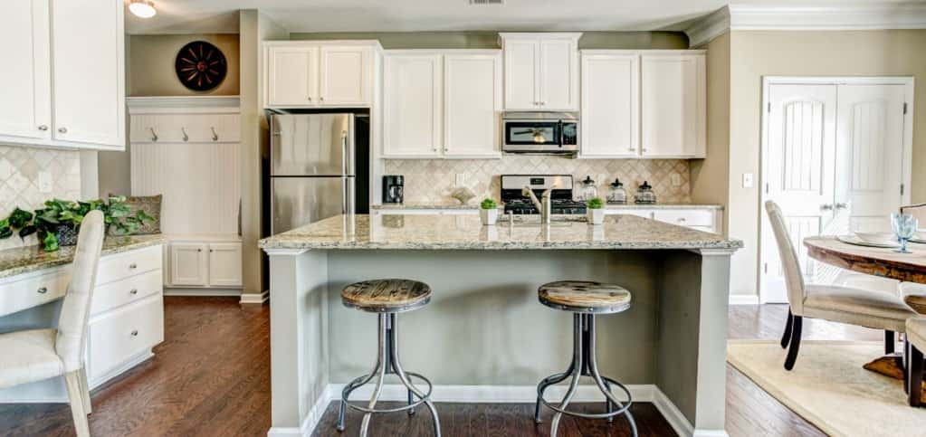 Today's homebuyer is busy, so this kitchen is ideal for meal prep. It also acts as the main gathering spot in the home.<br /> <br /> With a large kitchen island (granite countertops come standard in the kitchen) that can be used for meal prep or simply to take in a quick bite and a pantry, mudroom and breakfast nook nearby, the home can handle a flurry of activity or even a quiet meal.<br /> <br /> PHOTO COURTESY OF<br /> Smith Douglas Homes