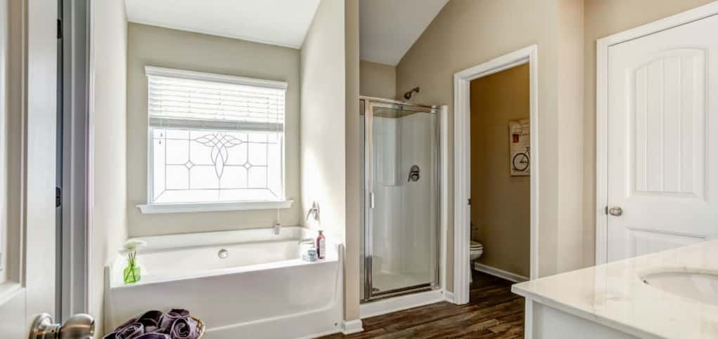 This spacious master bathroom is the ultimate spot to pamper oneself. A large privacy window brings in natural sunlight to this rest spot.<br /> <br /> Homeowners can easily prepare for the day with the double sink and separate water closet. Buyers can opt for the tub and shower for maximum versatility.<br /> <br /> PHOTO COURTESY OF<br /> Smith Douglas Homes