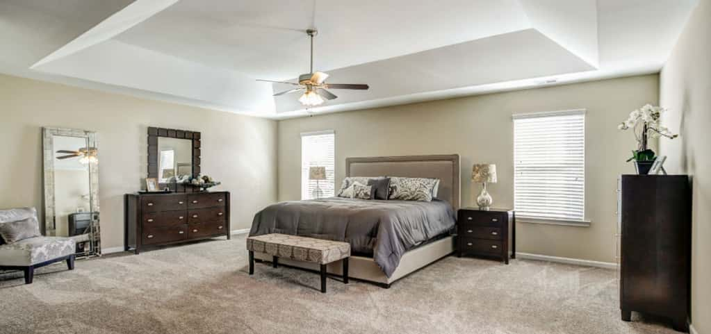 This model's tray ceiling in the master bedroom adds elegance and creates an even bigger space for homeowners to relax in at the end of the day. <br /> <br /> The spacious layout of the master bedroom means lots of flexibility and plenty of space for a king bed, nightstands, drawers and even a sitting space.<br /> <br /> PHOTO COURTESY OF<br /> Smith Douglas Homes