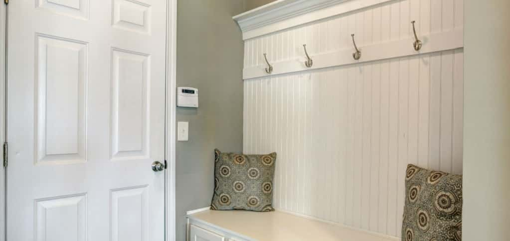 "An entryway mudroom is the perfect way to keep messy (or muddy) shoes or boots out of sight. A bench and batten board wall with hooks make it easy and convenient to store bags, coats and other items that could easily end up on tables or chairs.<br /> <br /> ""The home's mudroom is a good place to hang up coats or keys, without having to clutter up the rest of the home too much,"" Talbert says.<br /> <br /> PHOTO COURTESY OF<br /> Smith Douglas Homes"