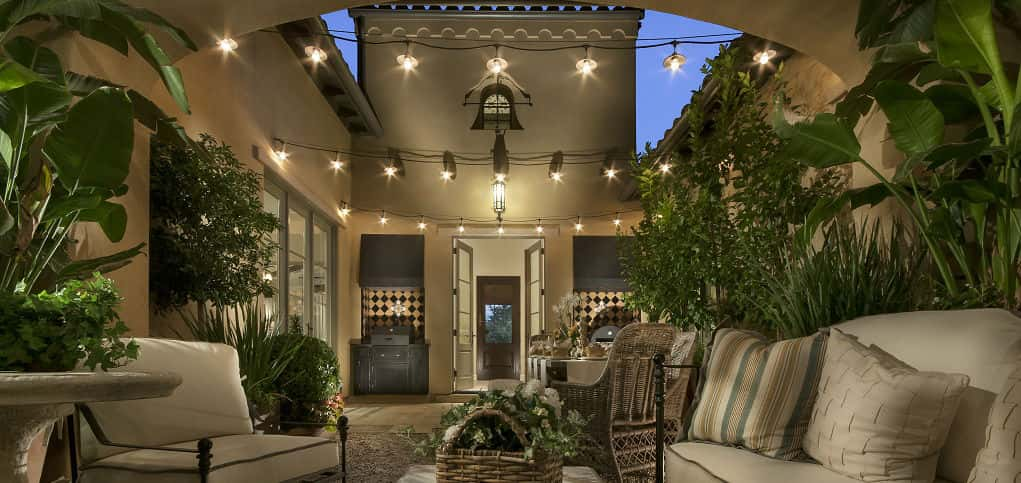 "An interior atrium greets homeowners and guests upon entering the home. A fireplace and pizza oven make the interior courtyard ideal for entertaining guests, rain or shine.<br /> <br /> ""That's the real 'wow' factor of the home,"" Beckert says. ""When the weather is really nice and the French doors are open, it's really a breathtaking moment.""<br /> <br /> PHOTO COURTESY OF<br /> Camelot Homes"