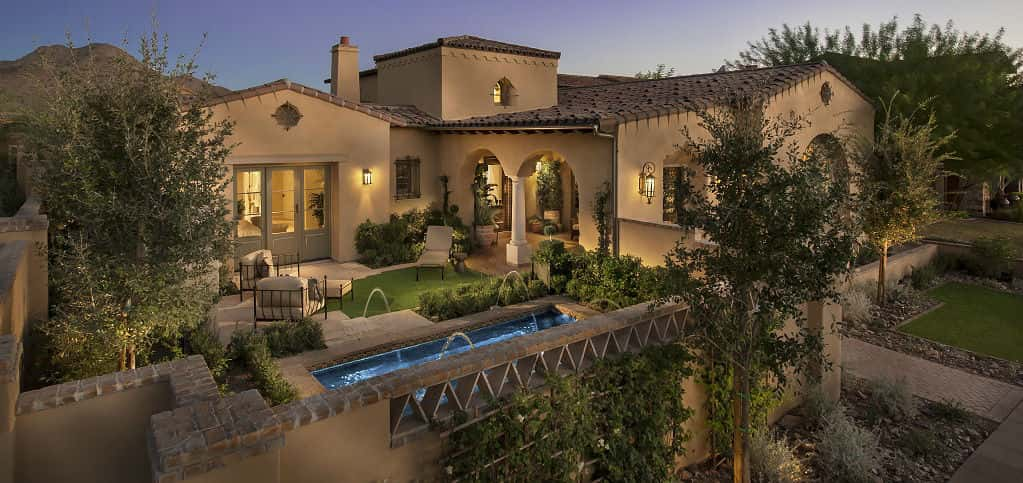 "A dramatic, walled-in entry complete with fountain and beautifully manicured lawn are sure to draw ""oohs"" and ""ahs"" from visitors to the 7721 Plan from Camelot Homes. The home's unique layout creates the perfect environment for outdoor living.<br /> <br /> The Mediterranean-style home uses the serene colors of the Southwest to find its place in the Verandahs at Silverleaf community, which Camelot Homes Managing Director Cammie Beckert calls the Beverly Hills of Scottsdale, Ariz.<br /> <br /> PHOTO COURTESY OF<br /> Camelot Homes"