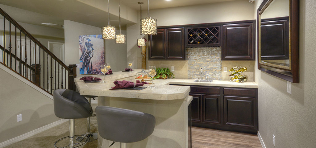 "Carnegie Plan<br /> Cordera in Colorado Springs, Colo.<br /> •	4 bedrooms/3 bath<br /> •	3-car garage<br /> •	3,890 sq. ft.<br /> •	Single-story home<br /> <br /> Photo: Campbell Homes' wet bar option adds even more opportunity for entertainment.<br /> <br /> PHOTO COURTESY OF<br /> Campbell Homes<br /> <br /> <a href=""https://www.newhomesource.com/homedetail/planid-966929"" target=""_blank"">Learn More About This Home On New Home Source</a>"