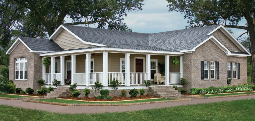 "Chat it up with neighbors or enjoy a cool summer night on the wraparound porch of Clayton Homes' Sequoia plan. This handsome exterior shows the versatility of <a href=""https://www.newhomesource.com/resourcecenter/articles/is-a-manufactured-home-the-right-choice-for-you"" target=""_blank"" title=""Is a Manufactured Home the Right Choice for You?"">manufactured homes</a>, highlighting both style and function. In this case, the home is ideal for entertaining.<br /> <br /> ""This floor plan provides the look and feel of a traditional site-built home,"" says Cal Davis, Home Building PR & Communications specialist for Clayton Homes. ""The open floor plan allows for ample room to congregate or entertain in common areas.""<br /> <br /> PHOTO COURTESY OF<br /> Clayton Homes"