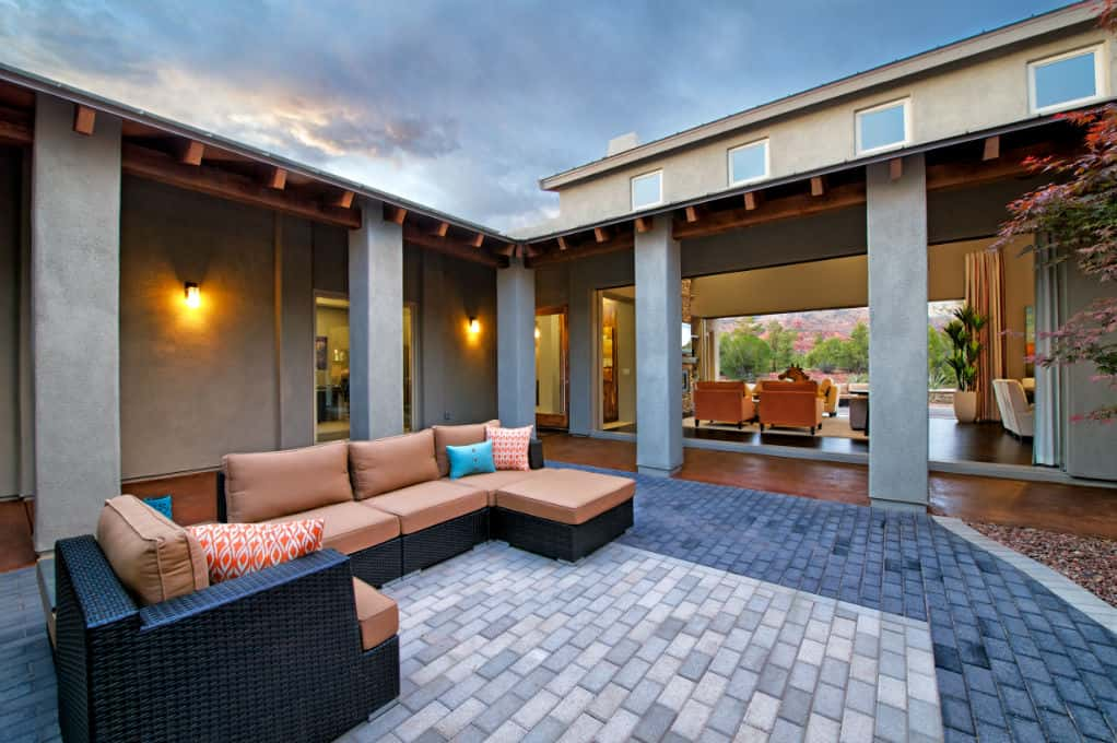 "An interior courtyard, like this one in the <a href=""https://www.newhomesource.com/resourcecenter/slideshows/home-of-the-week-enchantment-plan-by-dorn-homes"" target=""_blank"" title=""See More Photos of the Enchantment plan"">Enchantment plan</a> by Dorn Homes, is the perfect way for guests to wind down. Enjoy some hot cocoa, a warm fire and the evening sky in this outdoor space.<br /> <br /> When it's time for the party to end, guests can head in to grab their coats – and an extra serving of food! This space extends the home's living space, all while allowing guests to get a breath of fresh air.<br /> <br /> PHOTO COURTESY OF<br /> Dorn Homes"