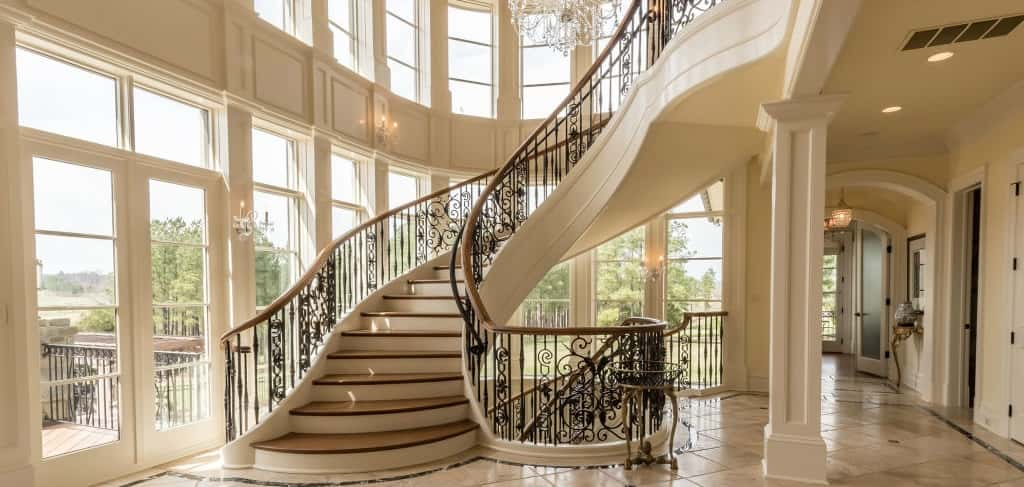 "Creighton Farms<br /> <br /> Aldie, Va.<br /> <br /> Photo: One home in the community features a stunning wrought-iron staircase surrounded by an abundance of windows.<br /> <br /> PHOTO COURTESY OF<br /> Southworth Development<br /> <br /> <a href=""https://www.newhomesource.com/communitydetail/builder-17358/community-68580"" target=""_blank"">Learn More About This Community on New Home Source</a>"