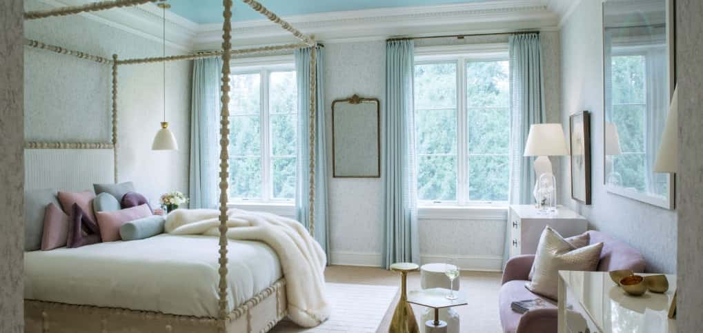 "<p><span>The high-gloss, turquoise ceiling provides an important function in this bedroom, named the ""modern professional's stylish retreat"": it creates a cozier proportion in a room with an extremely high ceiling. <br /> <br /> Designers Kiera St. Claire-Bowery and Dana Schwartz of Anthony Wilder Design/Build in Cabin John, Md., envisioned a woman named ""Sloane"" living in the room, which has a soft color palette and layers of fabric and velvet pillows on the floor, loveseat and bed.</span></p> <br /> <strong>PHOTO BY</strong><br /> Angie Seckinger"