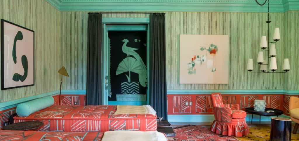 <p><span>Brave homeowners opt for a splash of color in a less-frequently used room or experiment with texture and patterns, but Washington, D.C., interior designer Caryn Cramer went bold with her Design House guest bedroom. Entered from a hallway painted vivid turquoise, mint and black, the bedroom features orange, mint and aqua fabrics made by Cramer. </span></p> <p><span> </span></p> <span>Layers of patterned rugs complement the textiles on the walls, which match the covers she made for the two Greek-style lounges that can be converted to beds for guests. The playfulness continues with a leather rug made of reclaimed belts and a horsehair stool.<br /> <br /> <strong>PHOTO BY</strong><br /> Angie Seckinger</span>