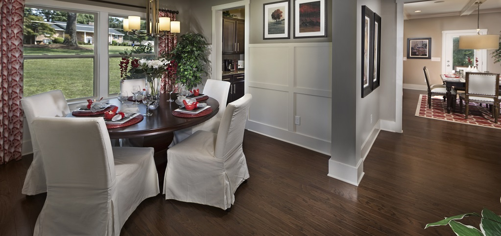 <p>High wainscoting brings a touch of classic elegance and brightness to the formal dining room, making the room the perfect place for that special dinner or party.<br /> <br /> The white trim nicely complements the dark hardwood floors as well as the dark cabinets of the adjacent butler's pantry.</p> <p> </p> <p>PHOTO COURTESY OF<br /> Charter Homes and Neighborhoods</p>