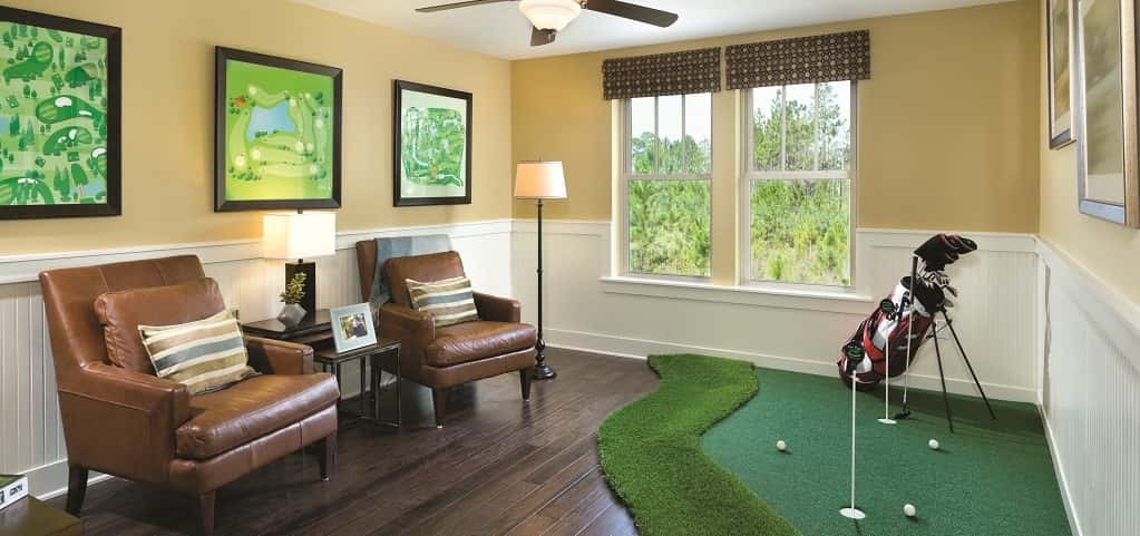 "Even if you have a small space for a media or game room, you can find a way to make it work. This little golfer's cove from <a href=""https://www.newhomesource.com/builder/david-weekley-homes/about/9"" target=""_blank"" title=""David Weekley"">David Weekley</a> is a prime example. Throw in a mini putting green and hang up a few golf course maps to create your own golfer's getaway. Love bowling, ping pong or playing pool? You could also take a few helpful hints from this design to create your own sporting space.<br /> <br /> PHOTO COURTESY OF<br /> David Weekley Homes"