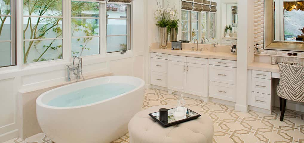 "The customized ""Contura"" free-standing tub invites visions of pure relaxation at the end of a long day in this spa-like master bath.<br /> <br /> Understated quartz marble countertops on the twin vanities and elegant lighting fixtures provide a calming backdrop to the decorative floor tiles and shower's hand-set tile surrounds.<br /> <br /> PHOTO COURTESY OF<br /> Davidson Communities"