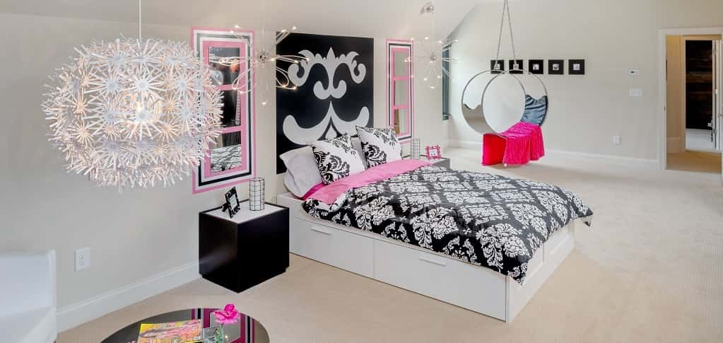 <p>With some modern and fun pink-and-black design flourishes, this upstairs bonus room transforms into a teenage girl's dream retreat with plenty of space for hanging out with friends, listening to music or just getting away from younger siblings for awhile.<br /> <br /> The room comes with its own walk-in closet and bath to create the perfect teenage suite. The bonus room can also be used in a variety of other ways depending on the family's needs, including as an office area or craft and hobby room.</p> <p> </p> <p>PHOTO COURTESY OF<br /> Traton Homes</p>