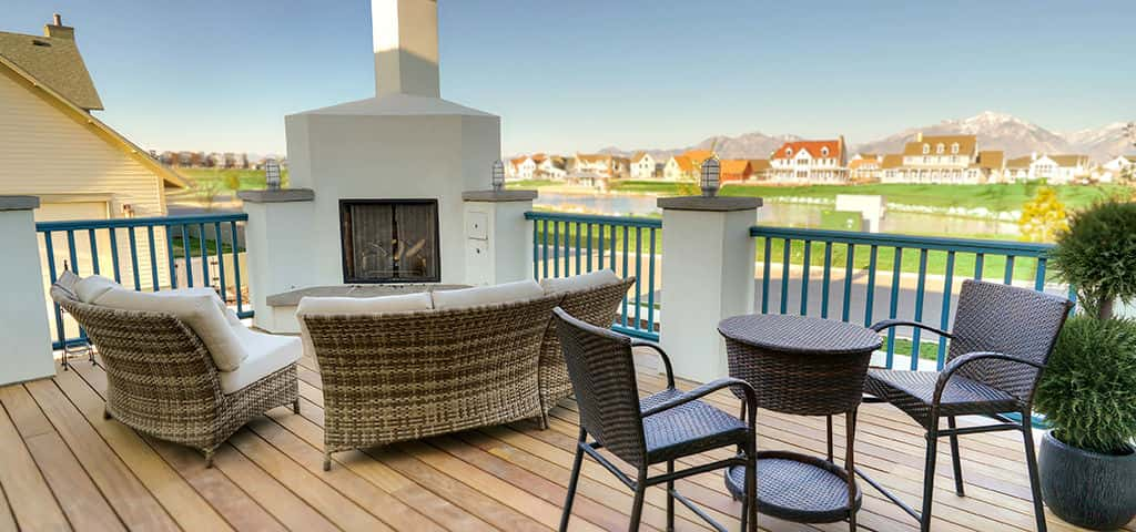 "One of the High Dining plan's most popular outdoor options, the back deck overlooks Daybreak Lake Village and Lake Oquirrh itself, along with a view of the distant Wasatch mountain range. Shown here with an optional fire place, the deck acts as seamless transition between the indoors and out. <br /> <br /> With easy access to both the kitchen and great room, you'll be hosting barbecues and cookouts in no time. ""People love relaxing on the deck and enjoying their lake views,"" says LaGiusa.<br /> <br /> PHOTO COURTESY OF<br /> Destination Homes"