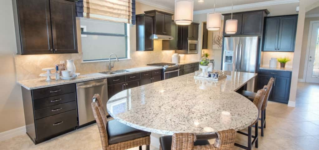 "<p>Who needs to carry out when you've got a spacious and lively kitchen like this one? A uniquely designed granite kitchen island is the focal point of the kitchen, yet also provides a prep space for cooks and eating space for diners.<br /> <br /> ""(The kitchen island) is ideal for everyday living and is also versatile enough to accommodate guest as well,"" Edwards says. ""Another key feature is the window above the kitchen sink, which provides great natural light to the entire kitchen.""</p> <p> </p> <p>PHOTO COURTESY OF<br /> DiVosta Homes</p>"