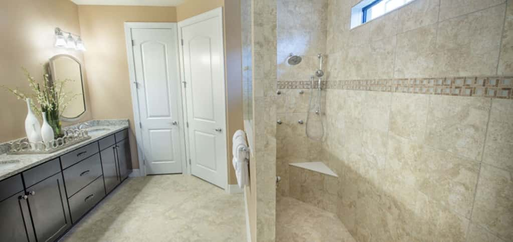 "<p>Double sinks, granite counter and a large walk-in shower make preparing for the day easy and comfortable. Edwards says the owner's bathroom was designed with functionality and flexibility in mind, something that came from consumer input.<br /> <br /> ""It's easy to see how consumers inspired our designs, especially when you see the owner's bathroom in the Martin Ray,"" she says. ""With double sinks, granite counters, a beautiful shower and the large walk-in closet, it's incredibly functional.""</p> <p> </p> <p>PHOTO COURTESY OF<br /> DiVosta Homes</p>"