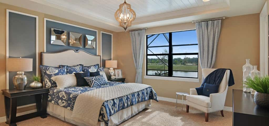 "<p>A standard white beadboard tray ceiling in the owner's bedroom creates visual interest where detail is often neglected. ""This ceiling detail gives the room character and draws the eye up, making the room feel larger,"" Edwards says.<br /> <br /> She adds that another favorite feature of the owner's bedroom is the walk-in closet, which provides plenty of storage space for homeowners. Buyers who want easy access to the back patio can choose an optional glass door.</p> <p> </p> <p>PHOTO COURTESY OF<br /> DiVosta Homes</p>"