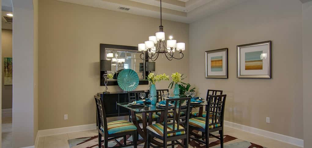 "The dining room can be outfitted any way that fits your family's needs. Here, the dining room is a place to host large gatherings.<br /> <br /> ""Today's families are multifaceted, with multigenerational, extended families and combined families,"" Krumpelbeck says. ""The need for a large dining space is usually a must.""<br /> <br /> PHOTO COURTESY OF<br /> Drees Homes"