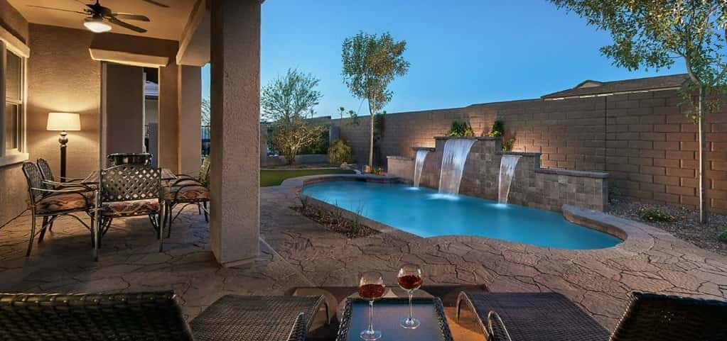 "Master-Planned Community<br /> <br /> Mesa, Ariz.<br /> <br /> Photo: The homes in Eastmark include many features, like the Annapolis Plan's back patio with swimming pool, that makes it easy to enjoy the outdoors.<br /> <br /> PHOTO COURTESY OF<br /> Eastmark<br /> <br /> <a href=""https://www.newhomesource.com/masterplan/96416"" target=""_blank"">Learn More About Eastmark on New Home Source</a>"