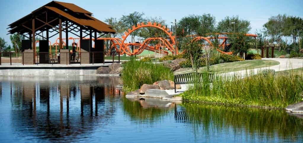 "At the heart of master-planned community Eastmark is a 14-acre park with plenty of activities for residents of all ages. From a climbing park dubbed the Orange Monster to a community pavilion sitting next to Riparian Lake, shown here, the park is the hub of connectivity for a true neighborly feel.<br /> <br /> ""At five square miles and 3,200 acres, the vision for Eastmark and opportunities were always big,"" says Garilyn Bourgeois, director of marketing for Eastmark.<br /> <br /> PHOTO COURTESY OF<br /> Eastmark"